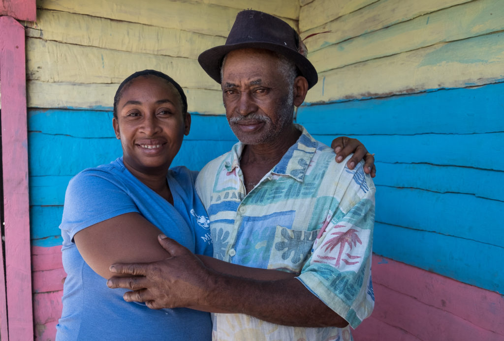 a midwife and her father at a Haitian rural mobile clinic; photo by Cheryl Hanna-Truscott